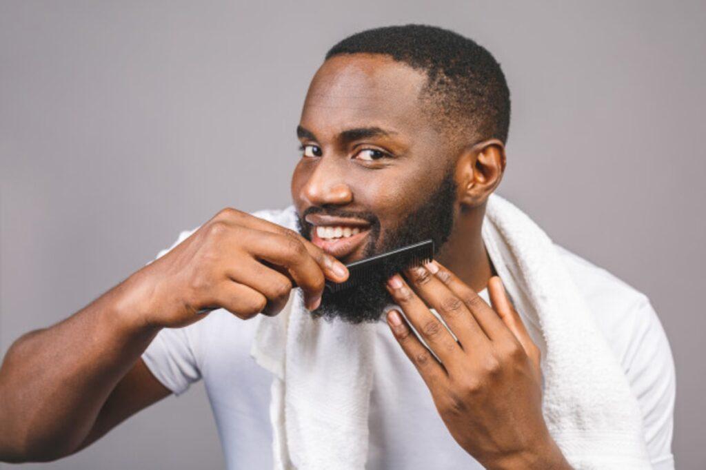 African man applying beard dye