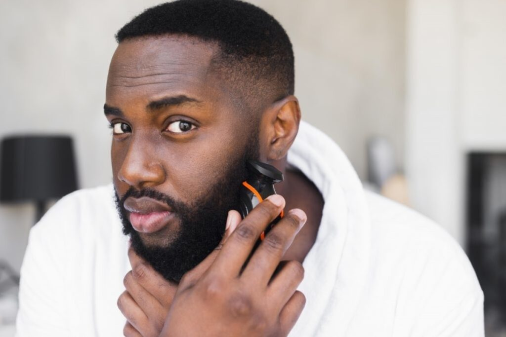 African American using the best beard trimmer